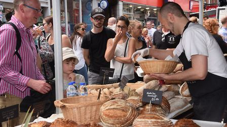 Crowds gather around the Penny Bun Bakehouse stall at the Beccles Food Festival. Picture: DENISE BRA