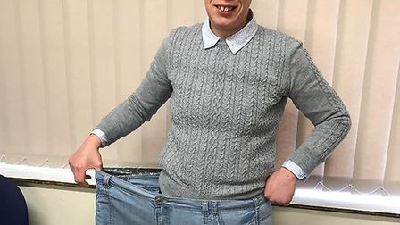 Claire Johnson, a member of the Worlingham Slimming World group, with a pair of her old trousers. Pi