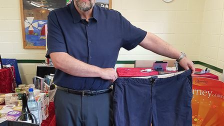 David Kneale from the Bradwell Slimming World group with a pair of his old trousers. Picture: Karley