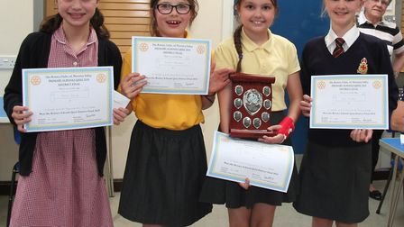 The winning St Edmund's and St Benet's schools quiz team with the quiz shield. Pictured from left is
