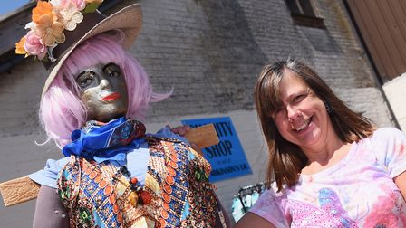 Jenny Bemment, manager of the Charity Shop in aid of Parkinsons UK, with Petunia, their hippy scarec