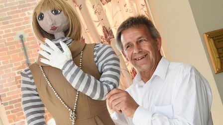 Funeral service operative, Jimmy Sturman, with the scarecrow in Youngs Funeral Service ready for the