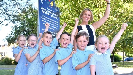 Staff and children from Worlingham Primary School celebrate an oustanding Ofsted report.Picture: Nic
