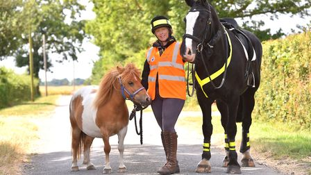 Local Police Volunteer Sarah Hills with her horses Robbie and Rhubarb.Picture: Nick Butcher