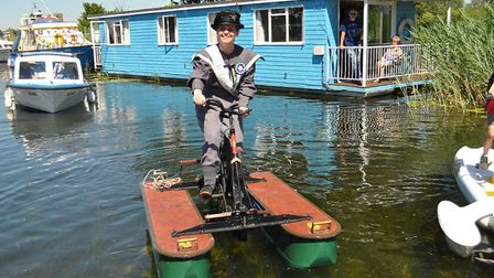 Beccles mayor Elfrede Brambley-Crawshaw taking part in a water bicycle race as part of Beccles Chart