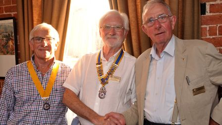 New vice-president Dennis Robbins with new president Paul Randle congratulated by his predecessor Jo
