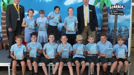 Children with their dictionaries at Ditchingham Primary School with Terry Reeve. Picture: Colin Bale