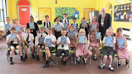 Children with their dictionaries at St Benet's School, Beccles, with Terry Reeve. Picture: Colin Bal
