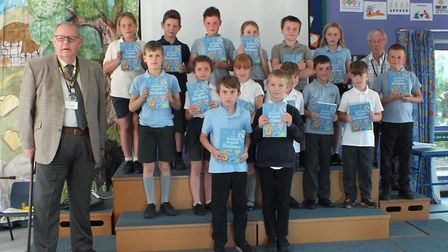 Children with their dictionaries at Ellingham Primary School with Mike Ingram. Picture: Colin Bale.