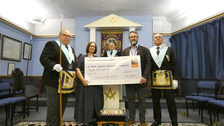 Members of the Waveney Freemasons present their cheque to EACH. Picture: EACH Norfolk