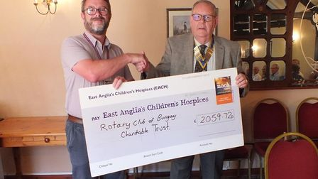 Bungay Rotary president Mike Ingram presenting a cheque to Tim Jenkins for the Nook Hospice appeal.