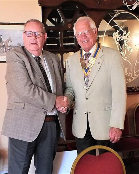 Mike Ingram installing Terry Reeve as the new club president. Picture: Colin Bale.