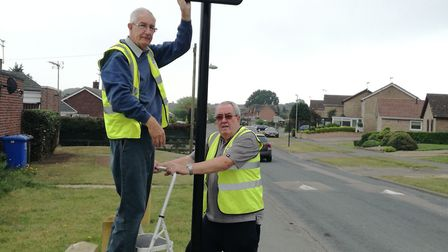 Beccles town councillors Graham Catchpole and Norman Brooks with one of the speed activated signs. P