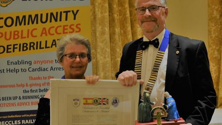 Vera and District Lions Club President Pam Mattioli holding the Declaration of Friendship with Beccl