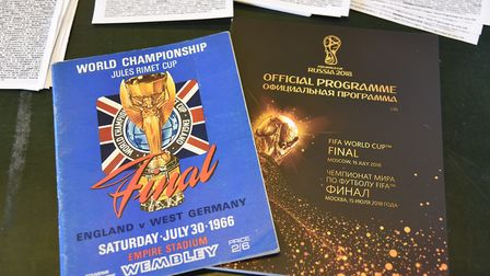 The programme from England's historic 1966 World Cup final victory, alongside a copy from the 2018 f