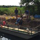 Volunteers from the Waterways Recovery Group are continuing work at Geldeston lock. Picture: Geoff D