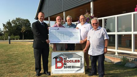 Richard Houston, manager of Waveney Memorial Park and Crematorium, presents a cheque for £5,000 to T