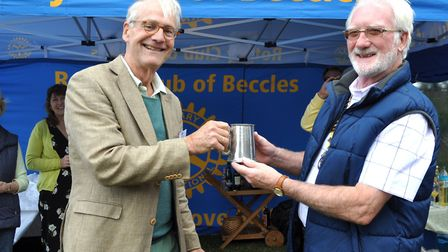 The exchange of the travelling tankard between Peter Hustinx and the Beccles club president Paul Ran