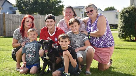 Rogue the dog who went missing for 5 days. Rogue, pictured with her family, (back left to right), At