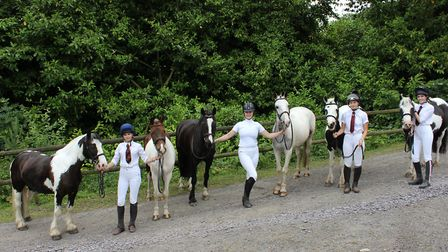 Moto, Clyde, Acer, Tom, Zowie and Noah with pupils at the Royal Alexandra and Albert School Riding C