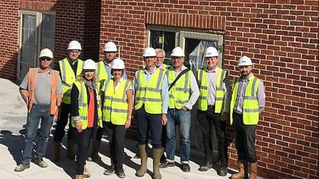 Robert Blackham and Sally Crawford surrounded by the design team of Dell House. Picture: Cygnet Care