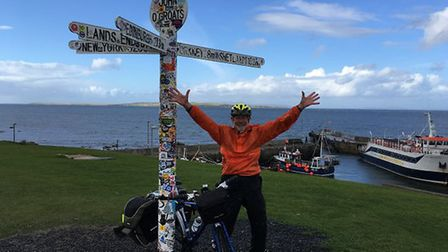 Peter Lanford celebrates reaching the finish line after 28 days cycling. Photo: Margaret Evans.