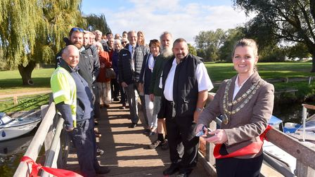 Beccles Town Mayor Elfrede Brambley-Crawshaw cuts the ribbon to mark the return of Beccles Quay to t