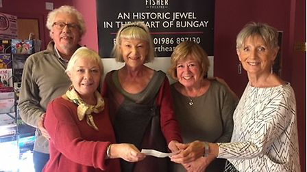 Sue Collins and Jan Hughes presenting the cheque to members of the Fisher Theatre: Sandra Cox, Paul