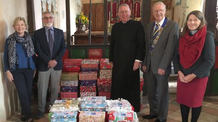 Beccles and Districts Lions Club donated 200 to Barsham Church's Love Box project. Photo: Beccles an