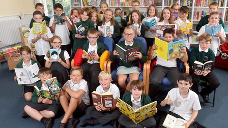 Pupils from Albert Pye Community Primary School, Beccles enjoying the new school library. The school