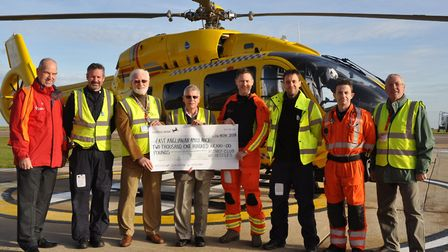 Pictured are the two pilots, Martin and Robin (in black), paramedic or doctor Jamie and Chris (weari