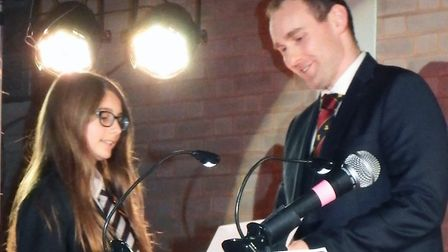 Rebecca Hind was presented with the creativity in KS3 Art and Design award by Mr Marjoram. Picture B