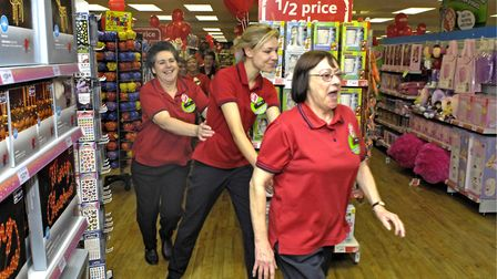 Staff dance around Beccles Woolworths in 2006. Photo: Bill Smith