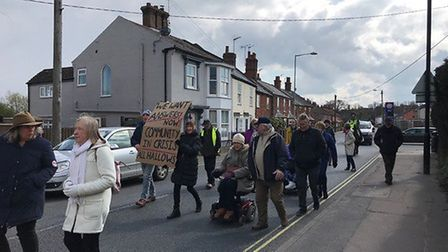 Protestors embarked on a slow walk through Bungay to protest against the proposed closure of All Hal