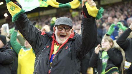 A Norwich City fan celebrates as the Canaries sealed promotion against Blackburn Rovers. Picture: Al