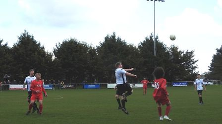 Harry Booker rises to head forward during Beccles Town's 5-1 win over Acle United last Saturday Pict
