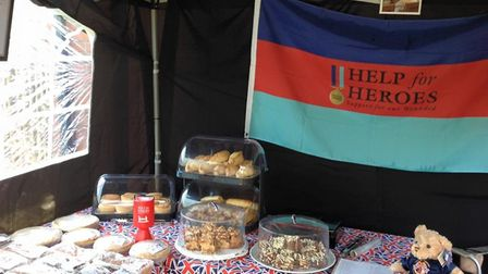 David Brown raised more than £1,000 for Help for Heroes at his annual Armed Forces Day cake sale. Pi