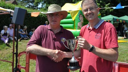 Rotarian Nick Rudge presents the Hospital Fete Cup to Gary Johnson of Helping Hands. Pictures: John