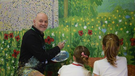 James Mayhew, a former pupil, spent two days working on the mural with pupils and his partner and co