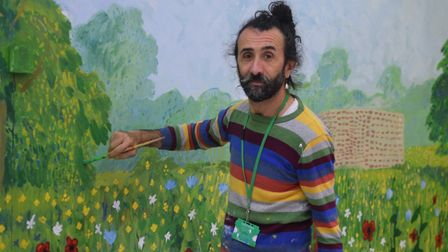 Toto has years of experience doing set design in theatre, which he used on the mural. Photo: Matthew