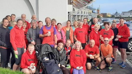 Rachel Allen and Graham Sampson celebrate their Parkrun milestone with clubmates and friends at Gorl