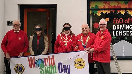 From left to right: Beccles Lions with blindfolded Mornie Weakley of Observatory the Opticians (seco
