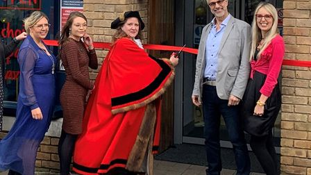 The Mayor of Beccles Andrea Carr cutting the ribbon with (from left to right) Julia Thurston, Mornie