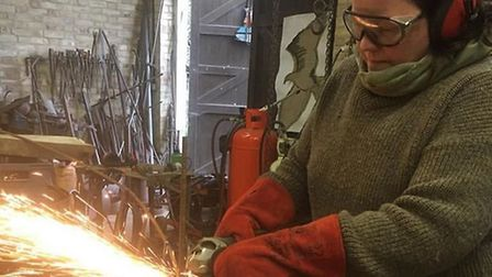 Sarah Cannell working with an angle grinder. Picture: Sarah Cannell