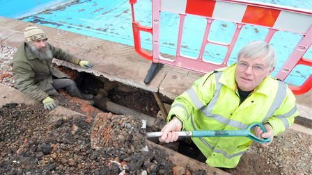 Graham Norgate (right) and Graham Elliott digging up the side of the Beccles Lido to find a leak.Pho