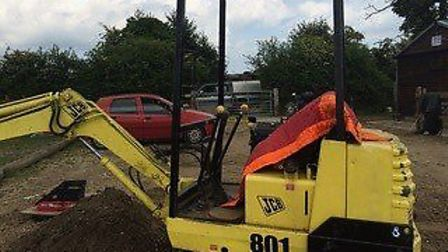 Police officers have released images of the stolen mini-digger and trailer. Photo: Suffolk Constabul