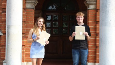 Rose Hicks and Lewis Kirby with their A Level results at Sir John Leman School in Beccles. PHOTO: Si