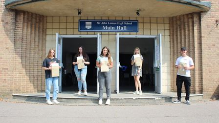 Lucy Thurbon, Maisie Webb, Chloe Rouse, Emily Takman and Jake Joyce with their A Level results at Si