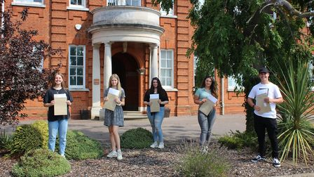 Lucy Thurbon, Emily Takman, Maisie Webb, Chloe Rouse and Jake Joyce with their A Level results at Si