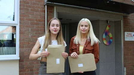 Jenna and Nicole Sarson with their A Level results at Sir John Leman School in Beccles. PHOTO: Sir J